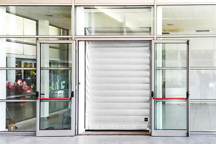 High speed roll-up freezer door